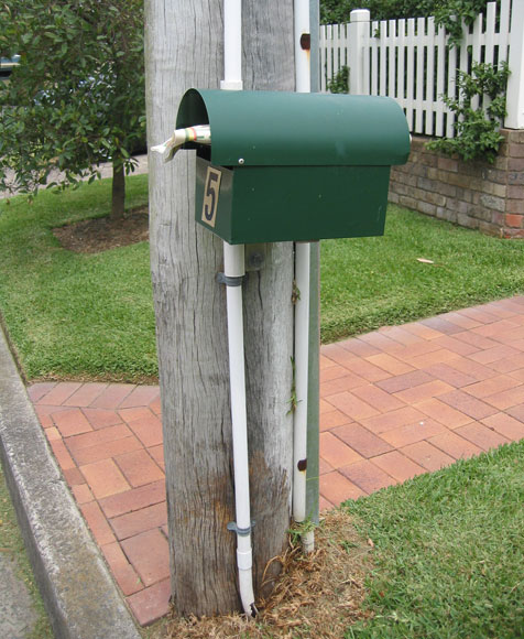 longueville-mailbox-power-pole-um.jpg